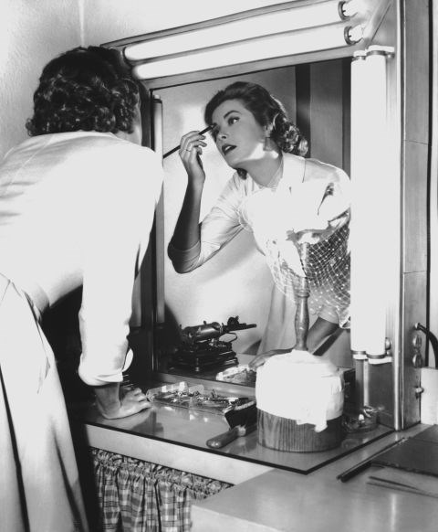 Applying makeup in 1954.