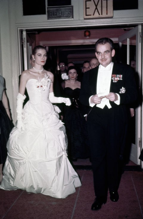 With her fiancé, Prince Rainier III of Monaco, at their engagement party in 1956.