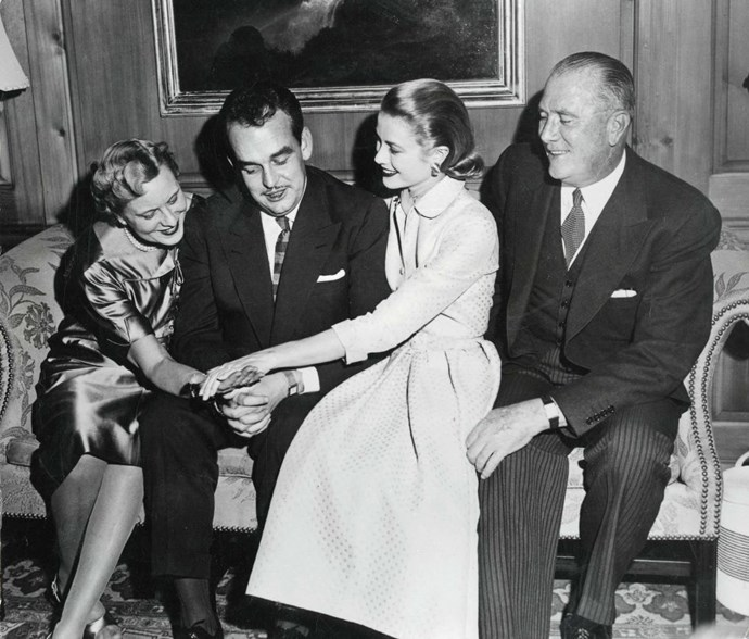Showing off her engagement ring to her mother with fiancé Prince Rainier on January 10, 1956.