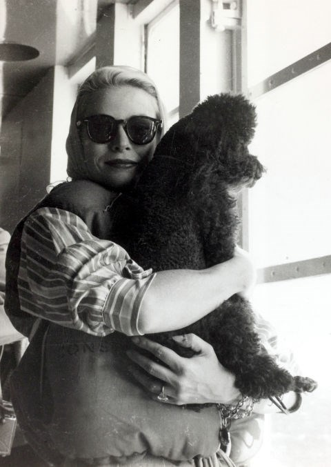 With her poodle on April 1, 1956.