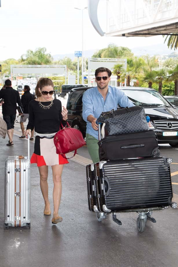 <p>May 25, 2013</p> <p>Olivia Palermo wearing a skirt from Zara with her husband Johannes Huebl departing Nice airport during the 66th Annual Cannes Film Festival.</p>