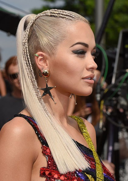 <strong>Rita Ora</strong> <br> <br> <em>Party girl hair and winged eyes</em>