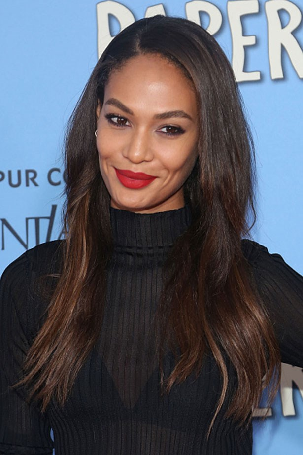 <strong>Joan Smalls</strong> <br> <br> <em>Matte red lips with a messy blow-out</em>