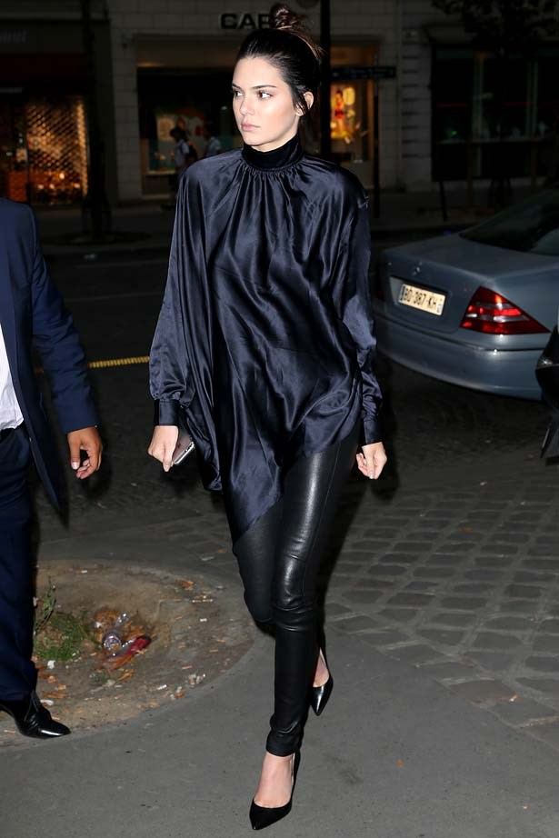 <p>June 26, 2015</p> <p>Kendall Jenner teams black silk with leather as she leaves a restaurant in Paris.</p>