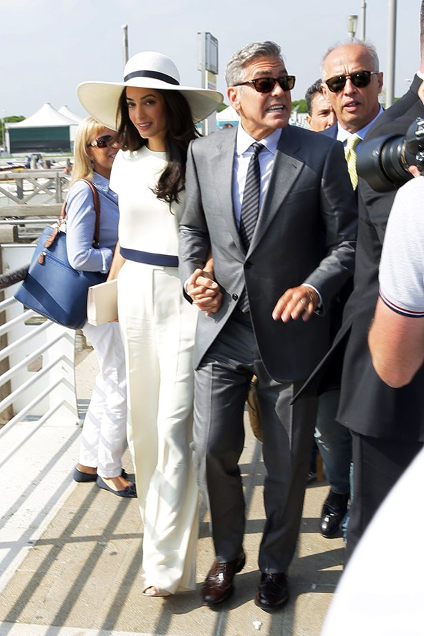 Amal Clooney wore the Stella McCartney pantsuit of dreams and wide-brimmed hat for her civil ceremony (to actually make the whole thing legit) and Oscar de la Renta for her lavish 2014 wedding to George Clooney in Venice.
