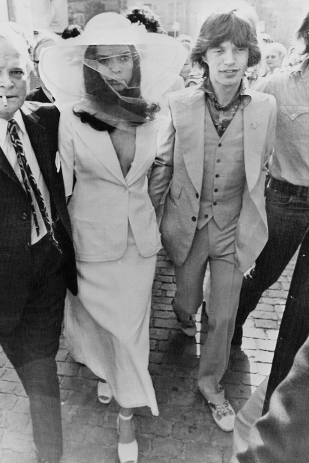 Bianca Jagger eschewed tradition in her 1971 wedding to Mick Jagger by wearing a tailored suit and wide brimmed hat.
