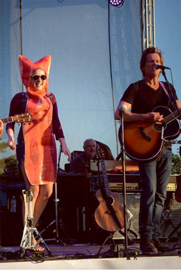 Hero woman dressed as a slice of bacon to a Kevin Bacon concert