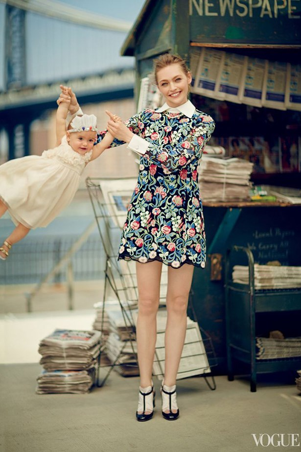 Sasha Pivovarova with her daughter, Mia, in Vogue.
