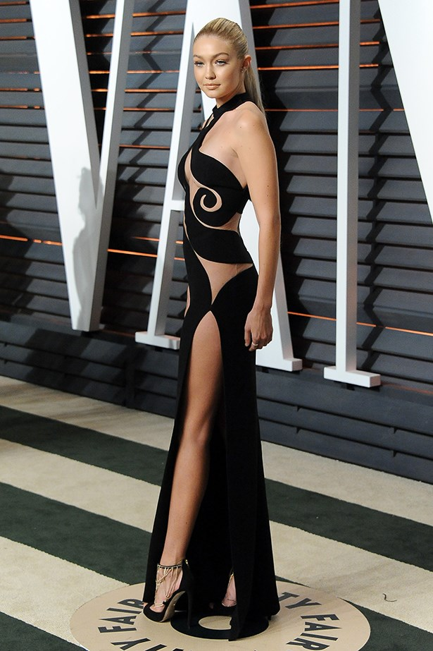 Our girl Gigi flaunted the tiniest bit of butt in her Atelier Versace dress at the Vanity Fair Oscars party.