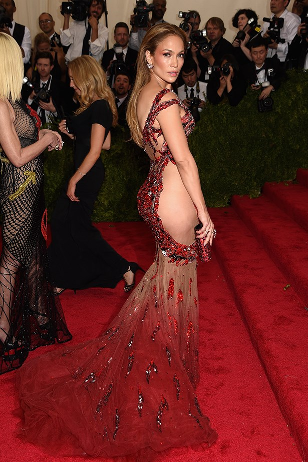 "Jennifer Lopez has gone the ""naked dress"" route many a time. Exhibit A: JLO in Atelier Versace at the MET gala."