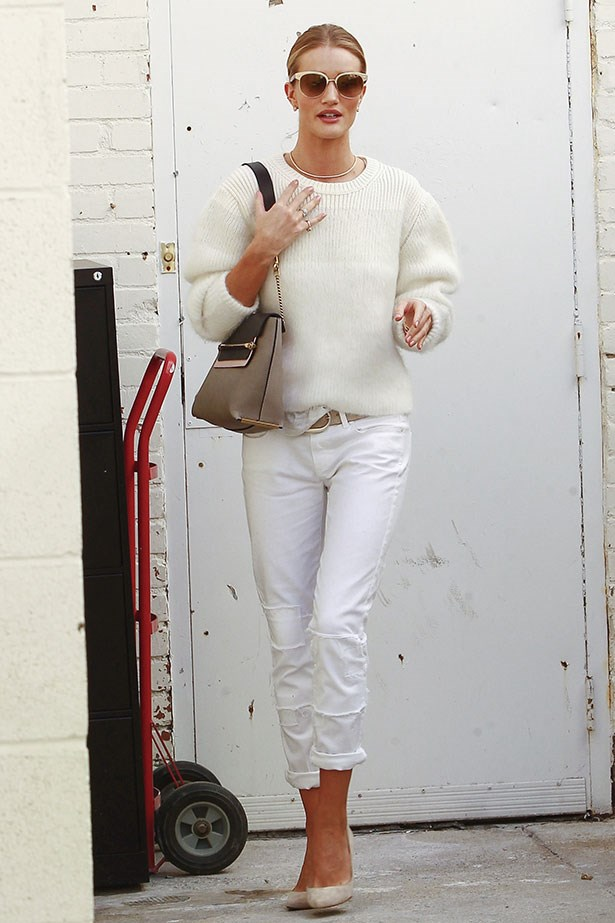 <p>This time styling them both with a cashmere sweater and oversized sunnies.</p>