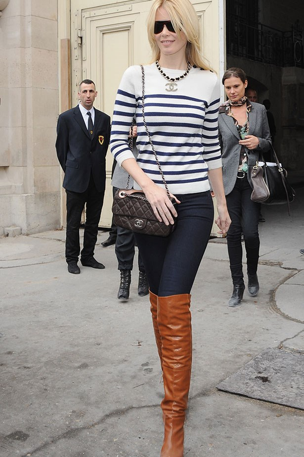 <p>It's not like Claudia Schiffer needs any added height but it's clear she loves her over-the-knee brown boots.</p>