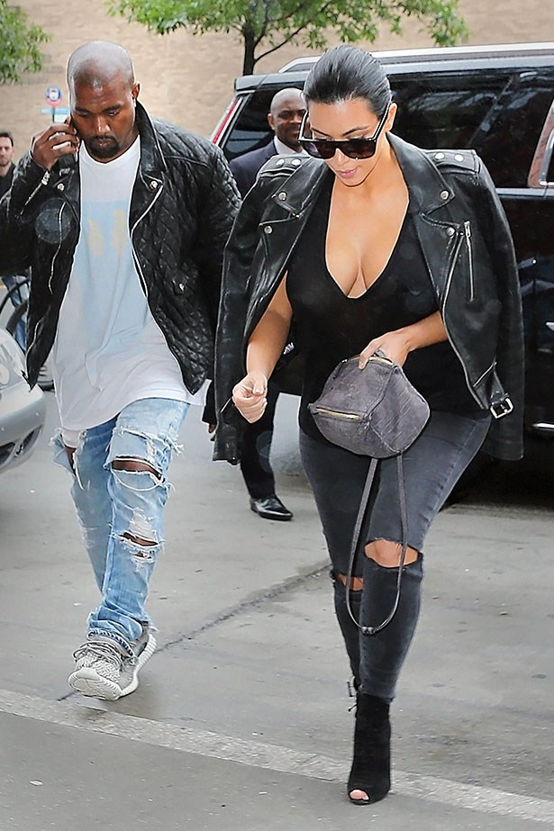 """<p>A few weeks later she repeats the outfit and adds a mini <a href=""""http://www.lanecrawford.com/product/givenchy/-pandora-mini-washed-lambskin-leather-bag/_/XVL649/product.lc?utm_source=Linkshare_AU&utm_medium=Affiliates&utm_campaign=Bags&countryCode=AU&utm_source=Affiliates&utm_medium=Affiliates&utm_campaign=Linkshare_AU&_country=AU"""">Givenchy Pandora</a> bag.</p>"""