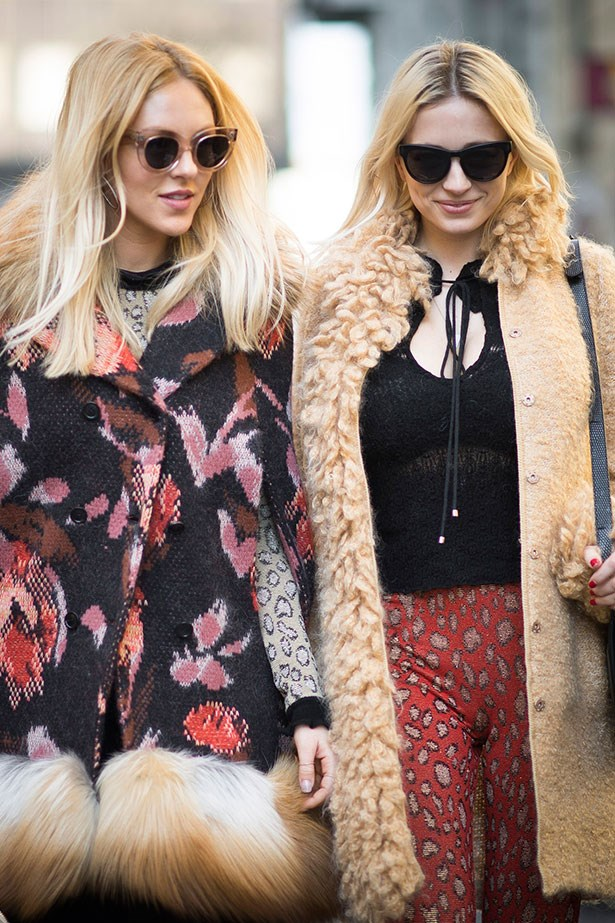 Caroline Vreeland and blogger Shea Marie wear go all out in 70s outfits during Paris Fashion Week.