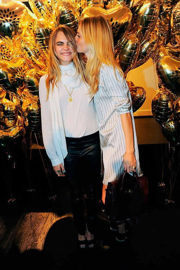 Cara and Poppy Delevigne are always there for each other. Cute!