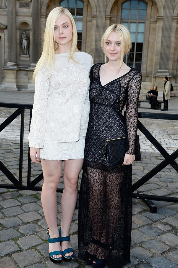 Elle and Dakota Fanning are precociously stylish. Here they are at Paris Fashion week in 2014.