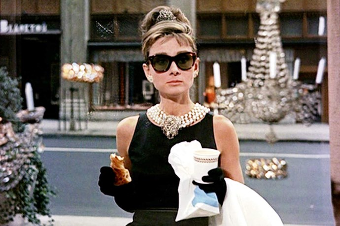 A list of fashion movies without this image of Audrey Hepburn as Holly Golightly in that Givenchy little black dress eating a croissant in front of Tiffany's? Not a chance!