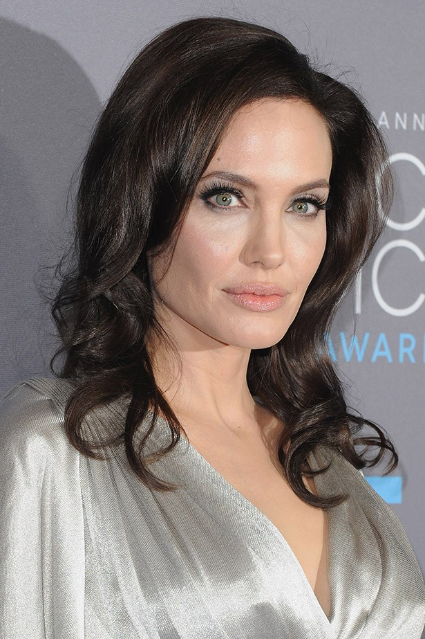Angelina Jolie, heart of gold and masses of love, vaguely terrifying when in repose.