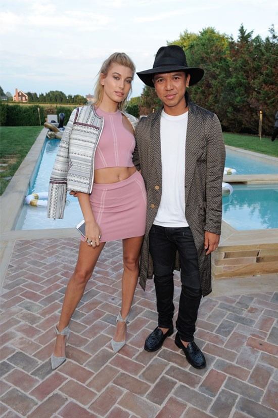 Hailey Baldwin opts for the matching crop ensemble, adding some oomph with the blazer over the shoulder.