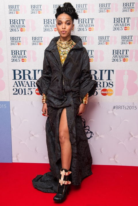 <strong>JANUARY 15, 2015</strong> <BR> In an Aganovich dress, Vivienne Westwood boots, and gold jewelry by Anabela Chan and Annelise Michelson at the nominations launch for the Brit Awards 2015.