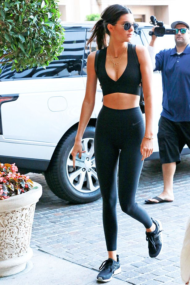 Look, ignore the guy creeping behind her with the camera, Kendall Jenner, has sexy gym gear down pat.