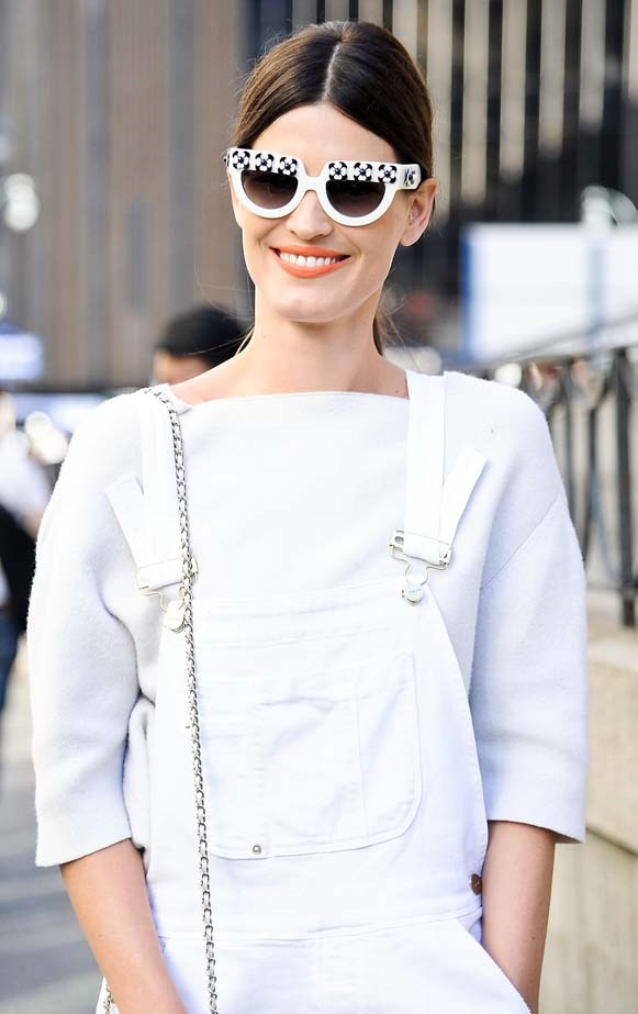 White on white polished off with Prada statement sunglasses.
