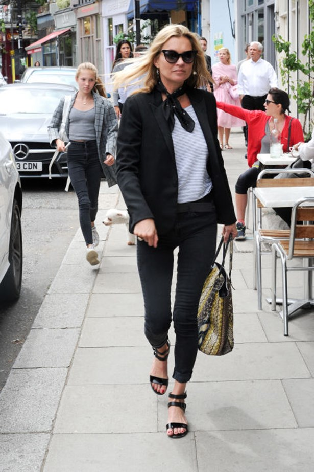 <p><strong>Who:</strong> Kate Moss</p> <p><strong>When:</strong> August 10</p> <p><strong>Why:</strong> Continuing her reign as the queen of the model-off-duty look, Kate Moss heads out in a classic Breton shirt and on-trend neck scarf. Still, the hottest accessory she's rocking is in her hands—a luxe python tote by Balenciaga.</p>