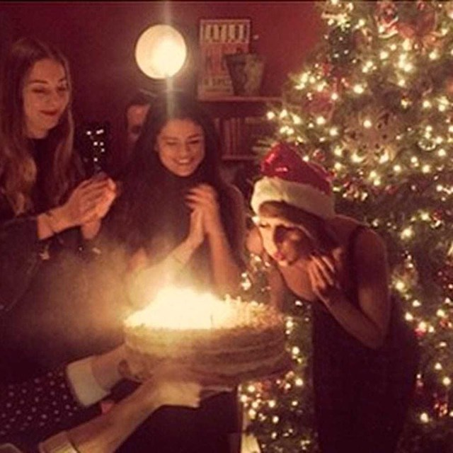 Taylor Swift celebrates her Christmas birthday with the Haim girls.