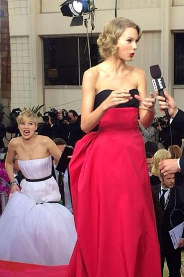 This particular JLaw photobomb at the 2014 Golden Globes became a  meme because LOOK AT HER FACE.