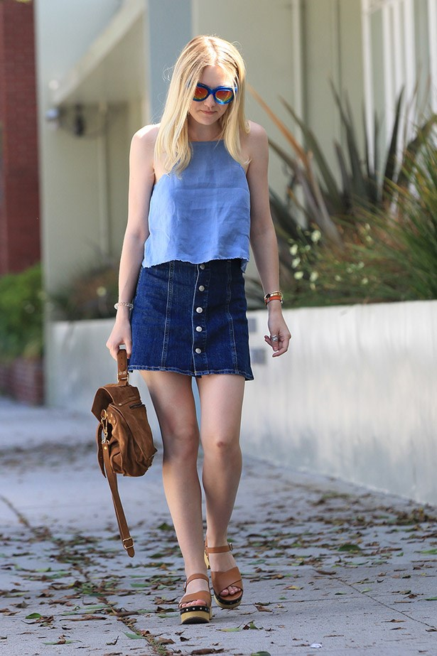 Dakota Fanning rocks a 70s vibe with a button-down blue.