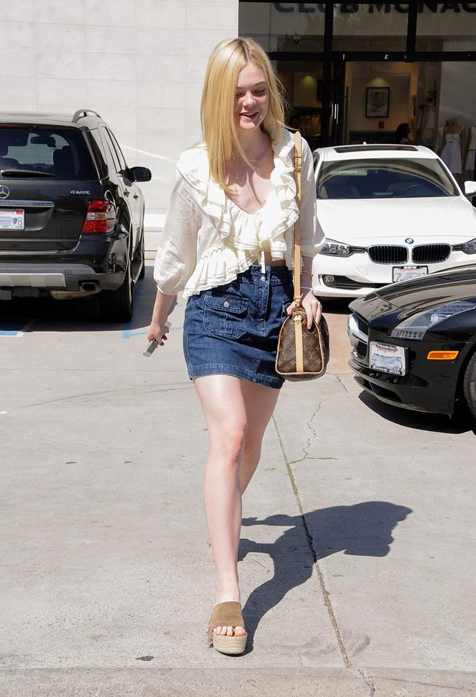 As does little sis Elle. That blouse!