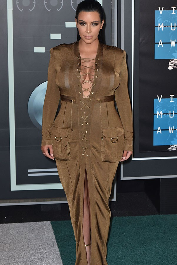 Kim Kardashian West was NOT a wallflower at the VMAS, tapping into the lace-up trend and, er, making the most of her assets in this Balmain safari-ish dress.