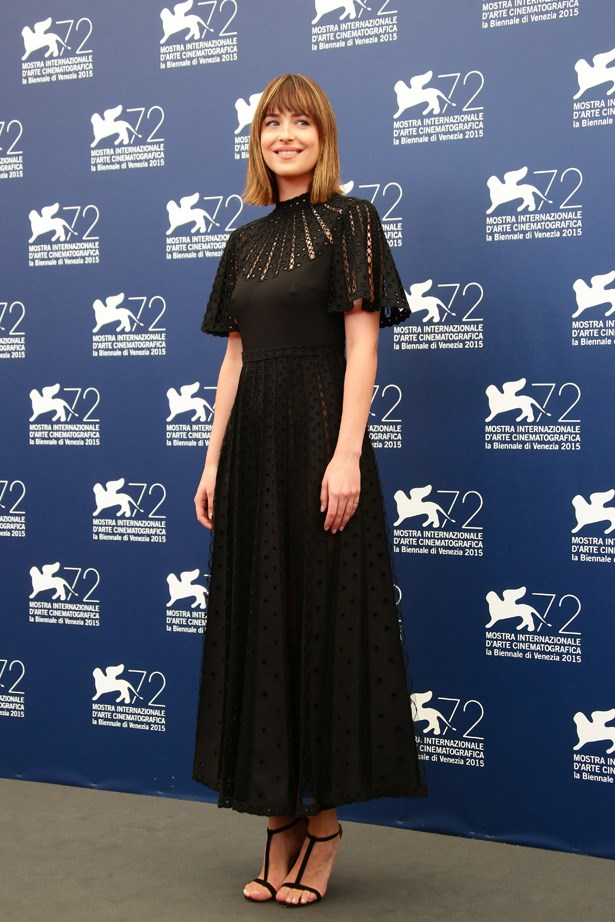 Dakota Johnson attends a photocall for 'Black Mass' during the 72nd Venice Film Festival.