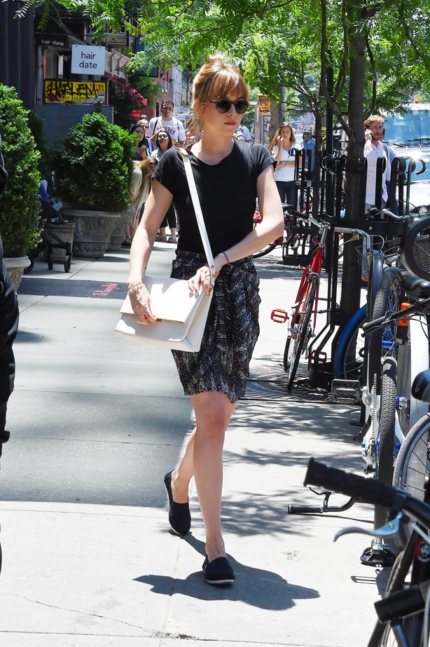Johnson in New York wearing an Isabel Marant skirt with a white Céline handbag.