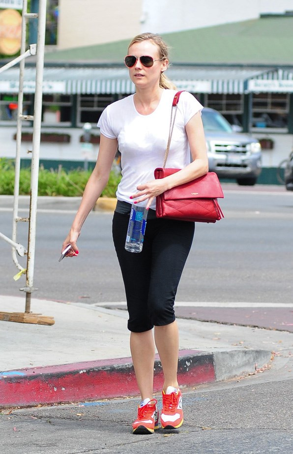 Kruger matches her trainers with her sunnies and Lanvin handbag.