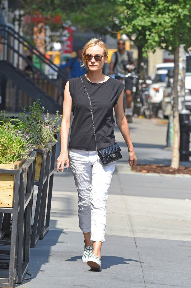 Kruger in Isabel Marant patchwork jeans and a mini Chanel bag.