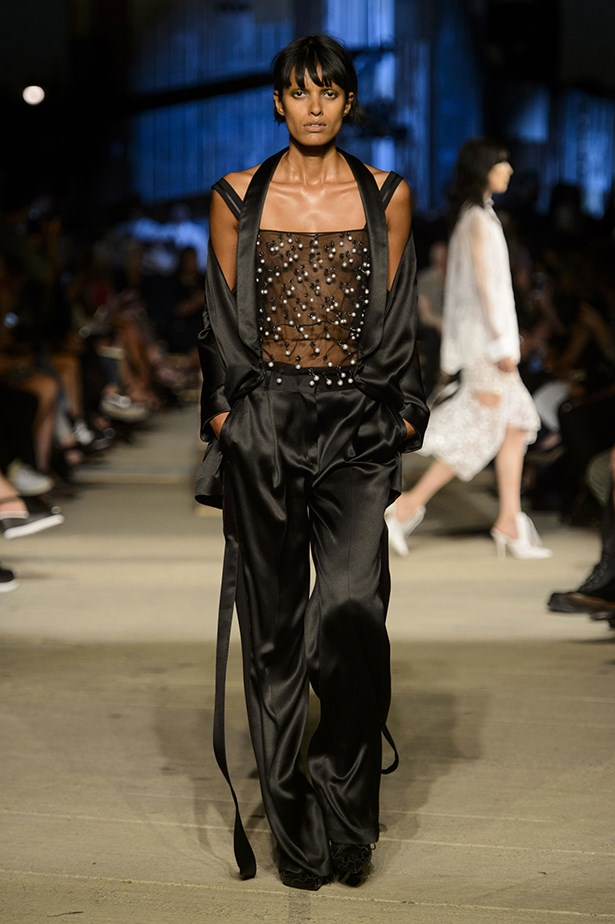 Ruling the runway well into her thirties, Bangalore-born model Lakshmi Menon is a Riccardo Tisci favourite and makes us want to rock this black silk satin ensemble – and that fringe.