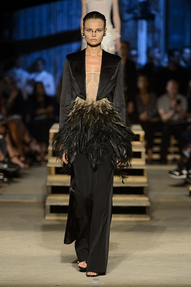 Giving new meaning to shaking your tail feather, Magdalena Frackowiak brings Givenchy's update on the classic black tux to life, nose piercing and all.