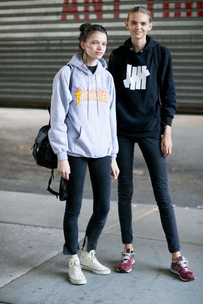 Borrow your boyfriend's hoodie and style with black skinny jeans.