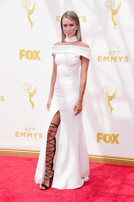 Renee Bargh toughens up her look with lace up heels at The Emmys.