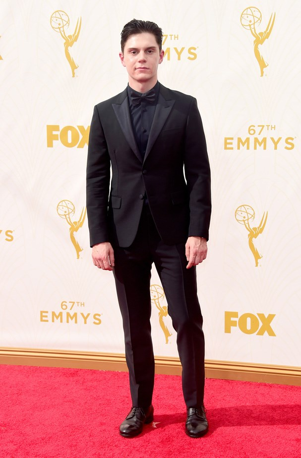 Evan Peters goes black on black with his suit choice.