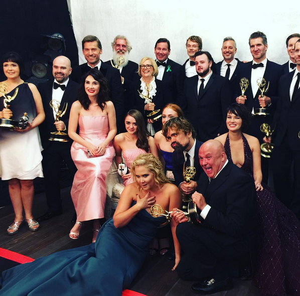 """Amy Schumer photobombed the cast of Game of Thrones at the Emmy awards and it was pure magic. She captioned the pic: """"my real family."""""""
