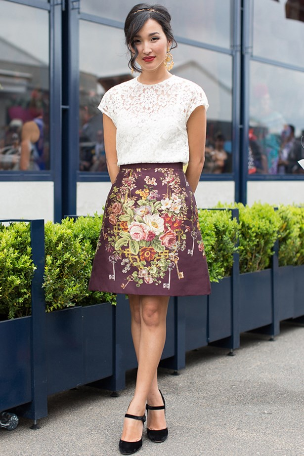 Going with separates over a dress, Nicole Warne paired her embroidered plum skirt with a white lace blouse, black mary-janes and a subtle gold headband.