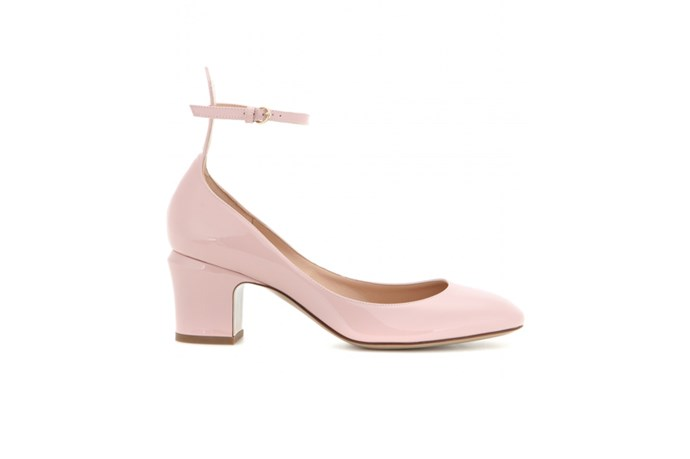 "<a href=""http://www.mytheresa.com/en-au/tango-patent-leather-pumps-452660.html"">Valentino, Tango patent leather pumps, $990.</a>"