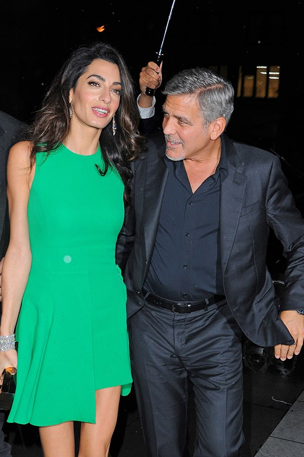 This is a tricky shade of green to pull off. But of course Amal Clooney can - she is gosh darn Amal Clooney and looks sensational in everything.<br><br> Also we would happily be employed as the person that holds Amal and George's Umbrella (ella, ella). Because, well, who wouldn't?
