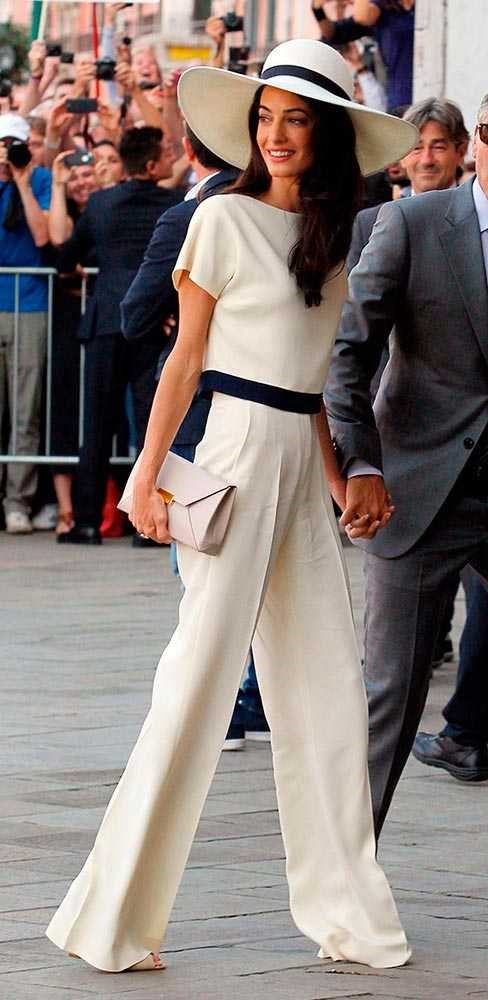 Sure, Amal Alamuddin wore Oscar de la Renta on her wedding day - but when she and Gorgeous George tied the knot for real, in a low-key civil ceremony, she did it in an ultra-chic cream trouser suit with matching wide-brimmed hat.