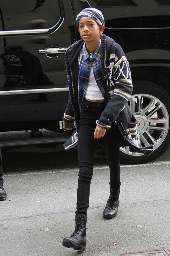 <strong>Willow Smith spotted in New York, 2013</strong> <BR> <BR> Willow pairs a flannel shirt with an oversized cardigan, not to mention the headscarf.