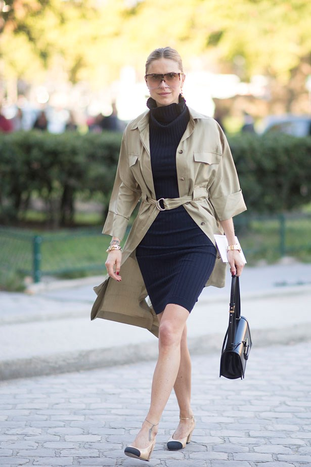Pernille Teisbaek keeps it classic in a navy dress and beige trench.