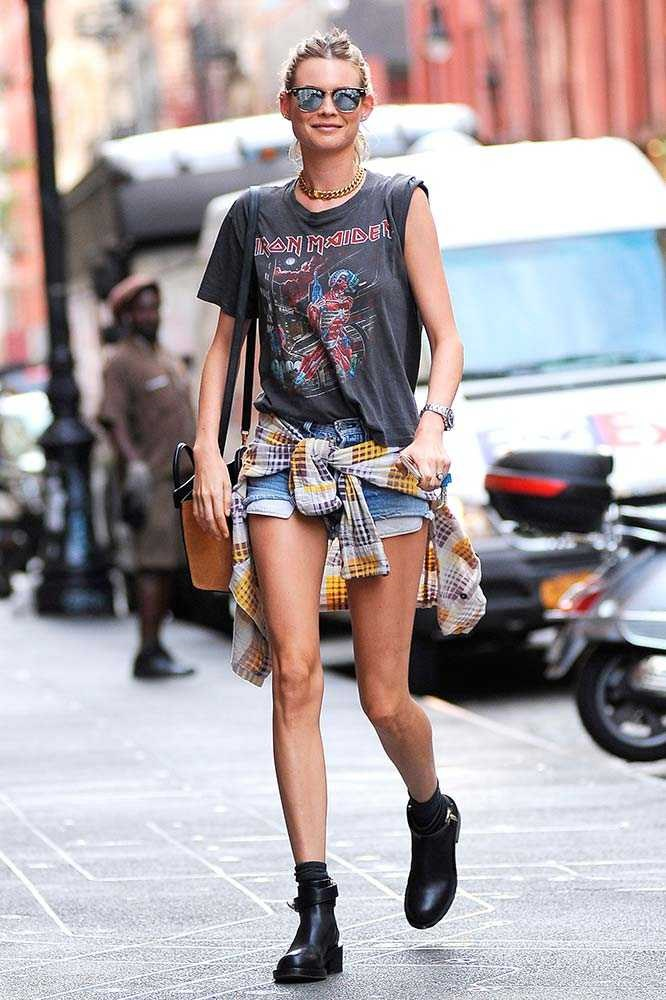 Behati Prinsloo works the age old combo of denim cut-offs and vintage band t-shirt.