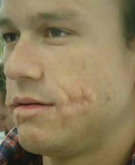 """<strong>The Dark Knight (2008)</strong> <br> <br> Heath Ledger with his Joker prosthetics but no makeup. <br> <br> Image: <a href=""""https://twitter.com/MakingOfs/status/623944356211388417/photo/1"""">Twitter</a>"""